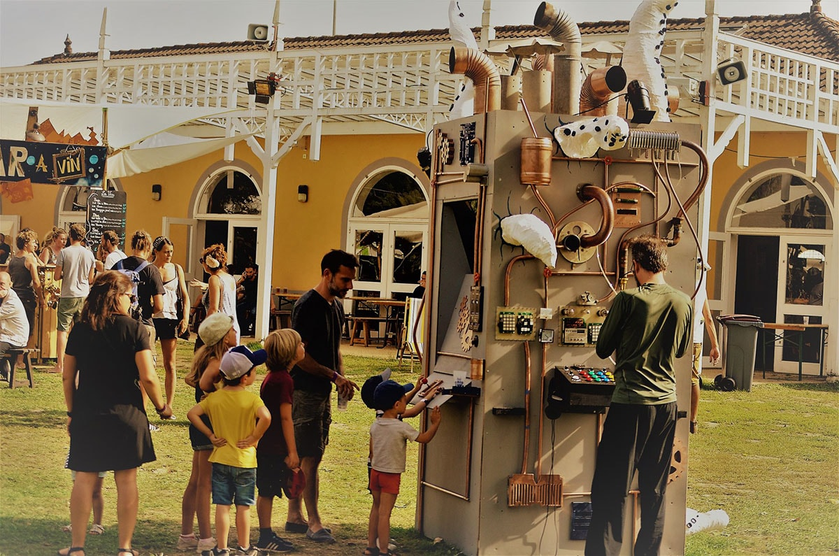Children queuing to play to game on the arcade machine during the festival